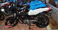 New Bajaj Pulsar 150 with Bright Red Logo, Grab Rail Etc Spotted at Dealer Warehouse
