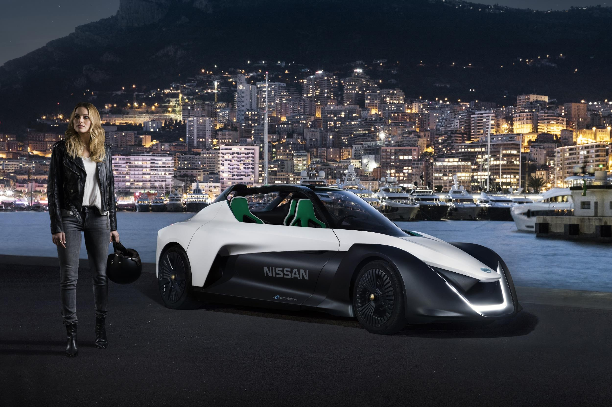 Margot Robbie posing with Nissan Electric Vehicle BladeGlider sports car